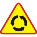 A-8 Skrzyżowanie o ruchu okrężnym. Ostrzega o skrzyżowaniu, na którym ruch odbywa się dookoła wyspy lub placu w kierunku wskazanym na znaku